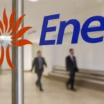People walk past the logo of Italy's biggest utility Enel at their Rome headquarter November 11, 2014.  REUTERS/Tony Gentile