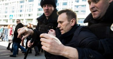 epa05871940 A handout photo made available by Navalny's Campaign Headquarters shows Russian opposition leader Alexei Navalny (C) being detained by Russian police officers during an opposition rally in central Moscow, Russia, 26 March 2017. Russian opposition leader Alexei Navalny called on his supporters to join a demonstration in central Moscow despite a ban from Moscow authorities. Throughout Russia the opposition held the so-called anti-corruption rallies. According to reports, dozens of demonstrators have been detained across the country as they called for the resignation of Russian Prime Minister Dmitry Medvedev over corruption allegations.  EPA/EVGENY FELDMAN FOR NAVALNY'S CAMPAIGN HANDOUT  HANDOUT EDITORIAL USE ONLY/NO SALES