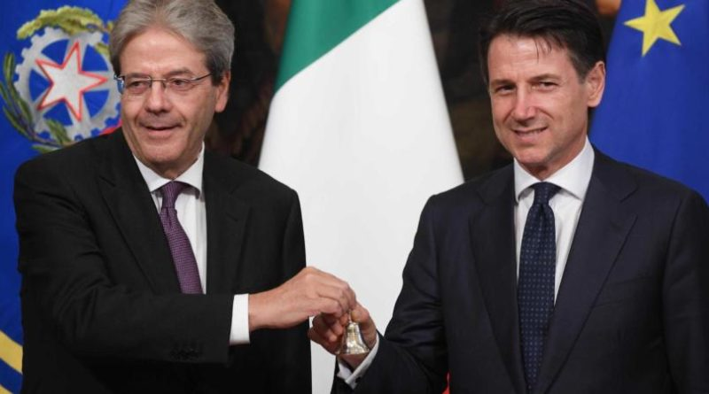 Newly appointed Italian Prime Minister Giuseppe Conte (right) receives from the outgoing Prime Minister Paolo Gentiloni (left) the small silver bell to open the First Council of Minister at Chigi Palace in Rome, 1 Jun 2018. ANSA/CLAUDIO PERI