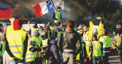 """TOPSHOT - People block Caen's circular road on November 18, 2018 in Caen, Normandy, on a second day of action, a day after a nationwide popular initiated day of protest called """"yellow vest"""" (Gilets Jaunes in French) movement to protest against high fuel prices which has mushroomed into a widespread protest against stagnant spending power under French President. (Photo by CHARLY TRIBALLEAU / AFP)"""