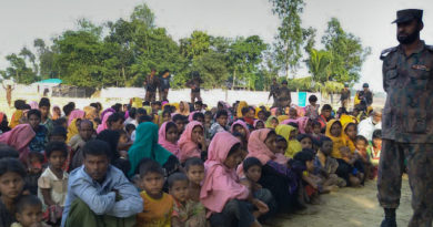 Rohingya Muslims from Myanmar, who tried to cross the Naf river into Bangladesh to escape sectarian violence, are kept under watch by Bangladeshi security officials in Teknaf on December 25, 2016.   Border Guard Bangladesh (BGB) personnel have intercepted 34 boats carrying some 340 Rohingyas at border points near Cox's Bazar. / AFP / STR        (Photo credit should read STR/AFP/Getty Images)