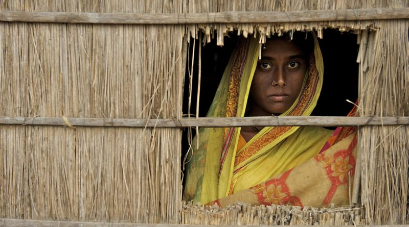 China, 15, looks out a window of her home in Uttar Bollar Hat, a village near the Bangladesh-India border. She and her husband, Mohammad Zakir, 18, moved to the village one week ago, after their home on a char, a river island, was destroyed by erosion. They were married three years earlier; China is now pregnant. Girls should be married when they are 14 to 15 years old, but it is common to marry them when they are 12 to 13 years old, said their neighbour, Mohammad Rohizuddin. One has to pay a dowry of about 20,000 taka (approximately US$288) when they are 12 to 13 years old, and it costs more to marry them off as they grow older. It could cost 30,000 to 50,000 taka (approximately US$430 to $720) to marry off a girl who is older. Demand for dowry also goes up if the girl is dark. For fair girls, [the girls parents] pay a smaller dowry.  In October 2009 in Bangladesh, children and women remain highly vulnerable to trafficking, sexual exploitation and physical abuse  a situation exacerbated by poverty, entrenched gender inequality and increasing inequalities between rural and urban populations. Domestic and international trafficking are common, with many children being sold into bonded labour or brothels. Violence against women is also widespread: In a 2005 World Health Organization (WHO) survey, 40 per cent of Bangladeshi women reported physical abuse by their husbands, and 43 per cent reported sexual abuse by husbands. An additional 20 per cent of rural women reported abuse by non-partners, including fathers, relatives and teachers. Girls are especially vulnerable to abuse; some 64 per cent of brides are under the legal age of 18 at marriage, and child brides suffer higher rates of physical and sexual violence. Though dowries have been illegal since 1980, the tradition persists, as does dowry-related violence. Most incidents of dowry violence go unreported, but at least 119 cases of dowry violence and 78 deaths were recorded by one local NGO in the first half of 2009. Abuse diminishes prospects for both women and their children: victims of abuse are less likely to receive antenatal care during pregnancy, and are less able to advocate for their children. Officials also face obstacles protecting the rights of children, including a birth registration rate of only 10 per cent, which puts most children beyond the reach of basic social services. UNICEFs life-skills programmes raise awareness of childrens rights and promote gender equality, addressing social issues including child marriage, dowry, reproductive health, trafficking and abuse. UNICEF also supports birth registration, a vital tool to ending child trafficking and marriage.