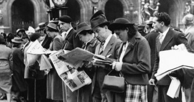 Parisians anxiously scan their newspapers for news of the European crisis on Thursday, August 28, 1939. This evening their eyes and the eyes of the world were on a conference between Adolf Hitler and Sir Neville Henderson, British ambassador to Berlin. (AP Photo)