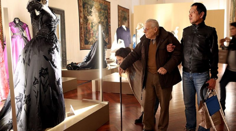 ROME, ITALY - JANUARY 16:  Italian costume designer Piero Tosi (L) looks his dress worn by Laura Antonelli for the movie 'The Innocent' by Luchino Visconti during the 'I Vestiti Dei Sogni' Exhibition Opening at Palazzo Braschi on January 16, 2015 in Rome, Italy.  (Photo by Franco Origlia/Getty Images)