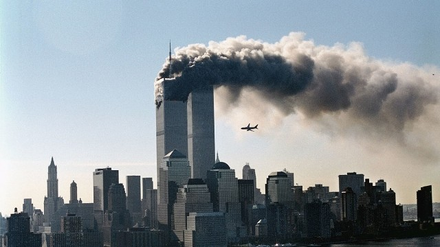 NEW YORK, NY- The second hijacked plane is seen moments before striking the second tower of the World Trade Center on September 11, 2001.  (photo credit:  Masatomo Kuriya/Corbis)