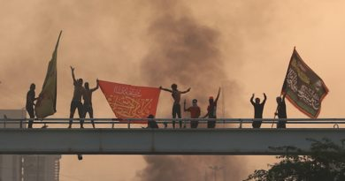 Anti-government protesters chant slogans during a protest in Baghdad, Iraq, Wednesday, Oct. 2, 2019. Iraqi officials said several protesters have been killed Wednesday and scores injured amid gunfire and clashes in Baghdad. (AP Photo/Hadi Mizban)