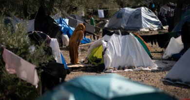 """MYTILENE, GREECE - OCTOBER 14: A woman walks amongst the tents in the unofficial camp which has evolved in the olive groves outside the Moria Refugee Camp on October 14, 2019 in Mytilene, Greece. Moria migrant camp was built for 3,000 people but is now believed to contain up to 14,000 and has sprawled into the neighbouring olive groves. Migrants have dubbed the new camp 'The Jungle"""". Authorities have begun to relocate refugees and migrates from overcrowded island hotspots to facilities on the mainland in a bid to ease pressure on the island camps, as the flow of new arrivals from neighbouring Turkey continues. (Photo by Christopher Furlong/Getty Images)"""