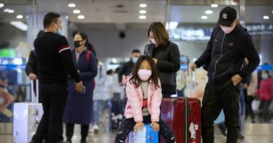 Travelers wear a face masks as they stand in the arrivals area at Beijing Capital International Airport in Beijing, Thursday, Jan. 23, 2020. China closed off a city of more than 11 million people Thursday, halting transportation and warning against public gatherings, to try to stop the spread of a deadly new virus that has sickened hundreds and spread to other cities and countries in the Lunar New Year travel rush. (AP Photo/Mark Schiefelbein)
